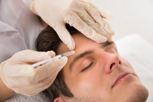Man getting a botox treatment