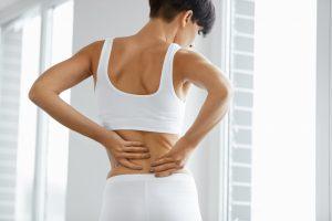 Woman having a back pain