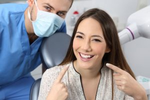 Dentist with patient smiling