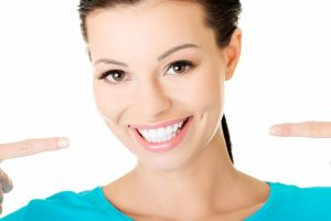 Woman showing her white teeth