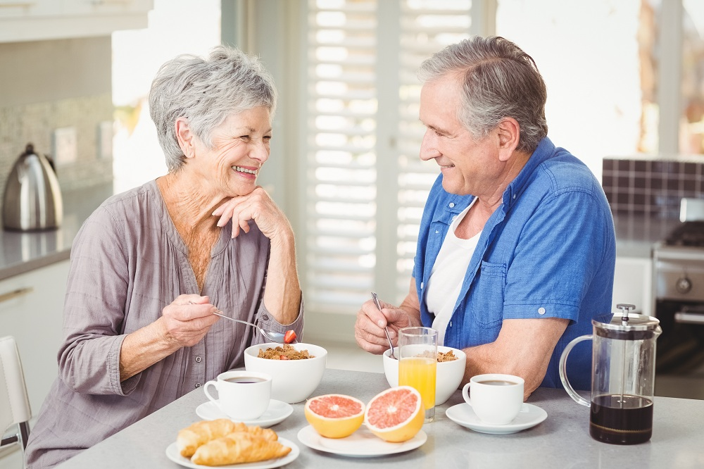a senior couple having breakfast