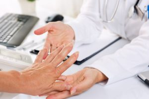 doctor examining patient with rheumatism