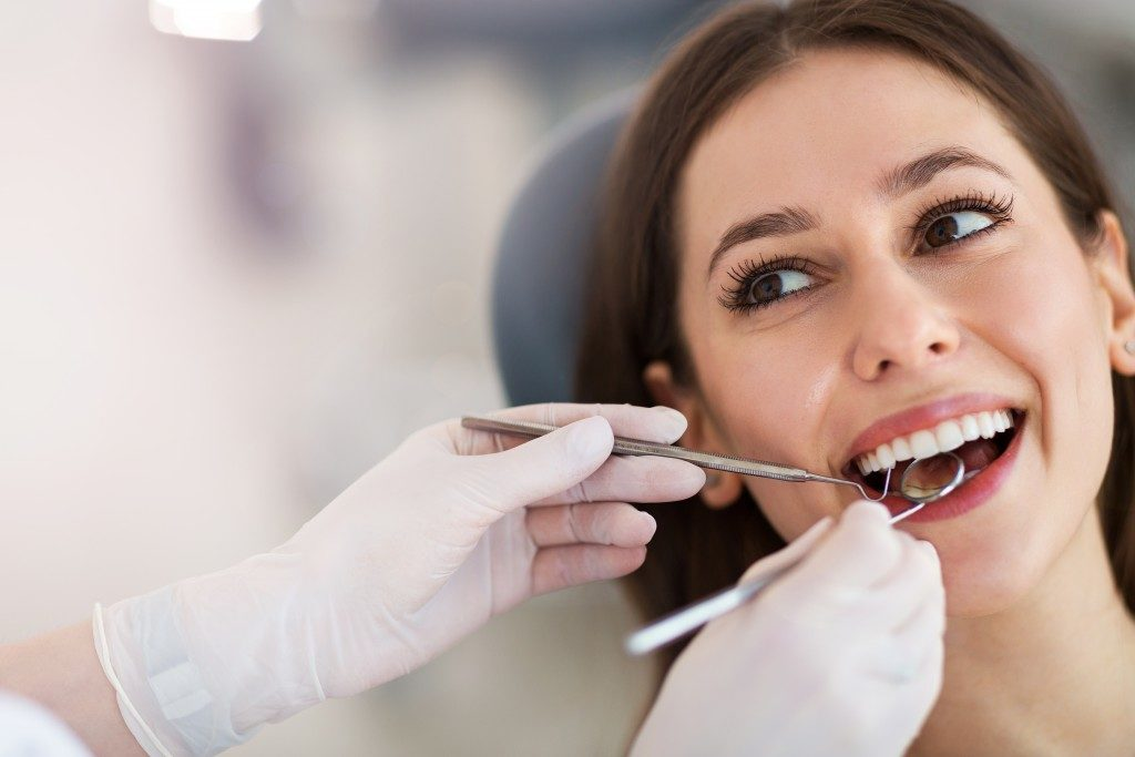 woman having her dental check up
