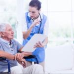 nurse talking to old man