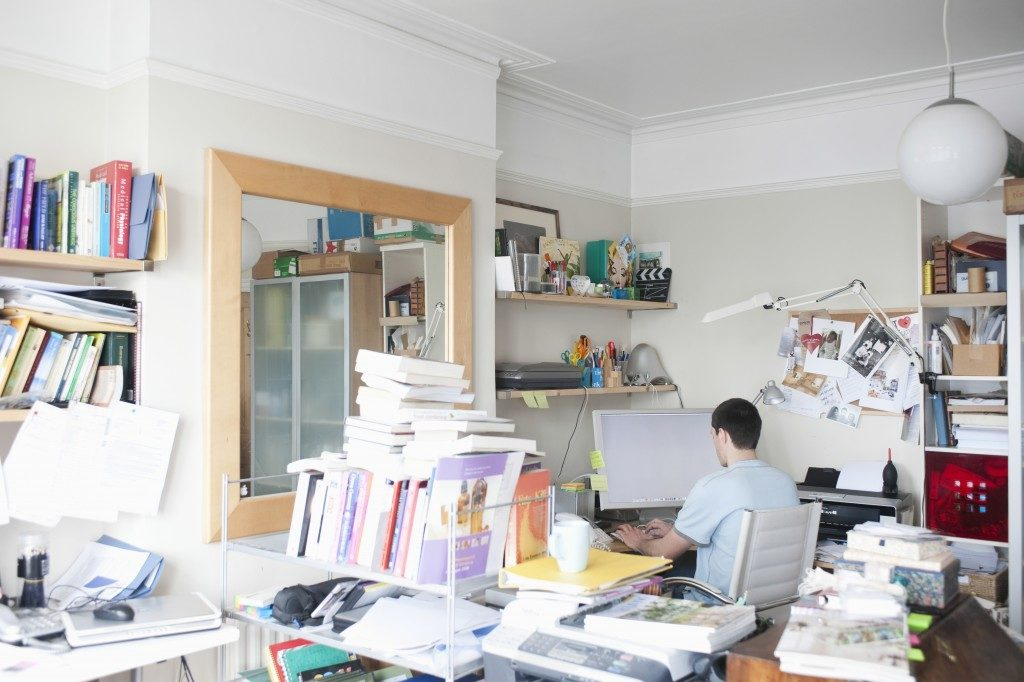 Man working in a cluttered environment