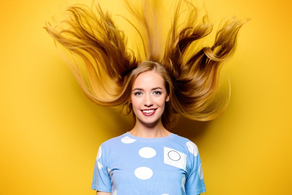 Woman's hair falling down