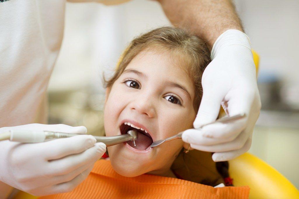 Girl having a dental checkup