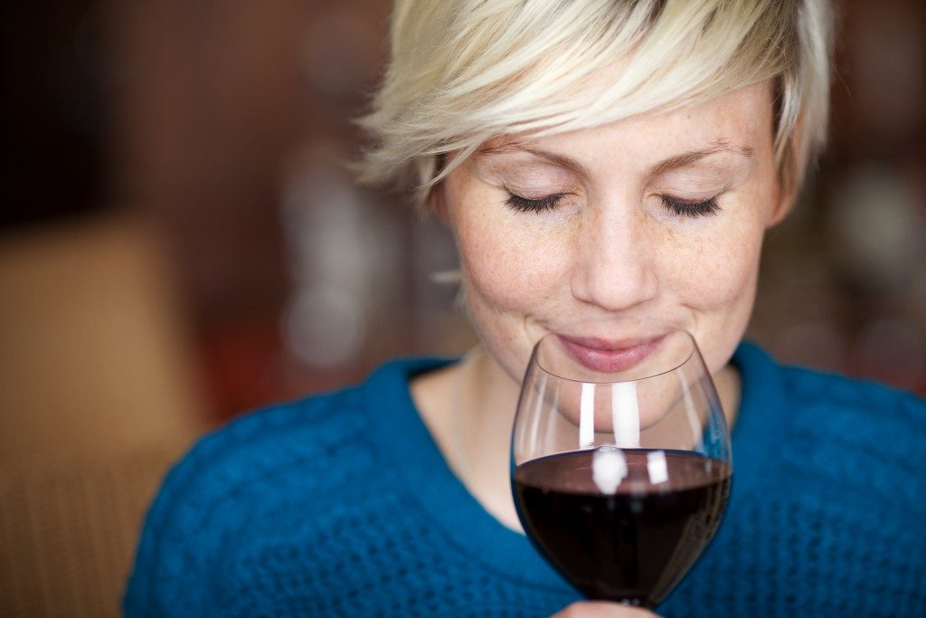 Woman smelling the wine