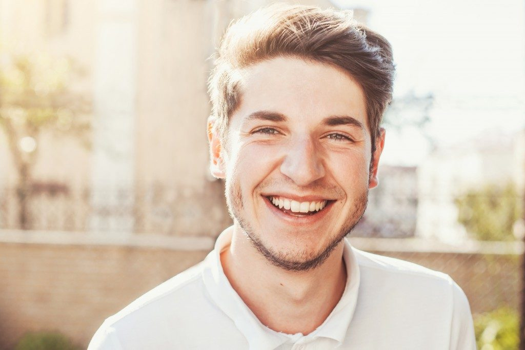 Man smiling, looking in the camera
