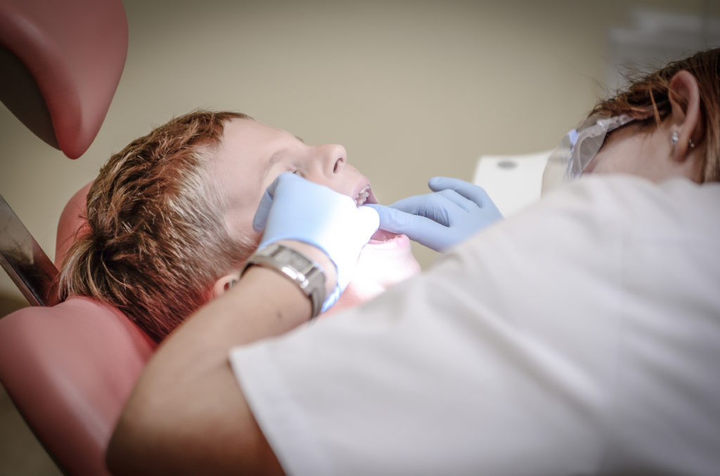 boy-check-up-dental-care