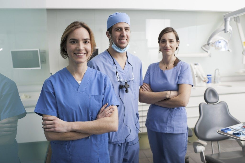 Group of dentists and their assistants