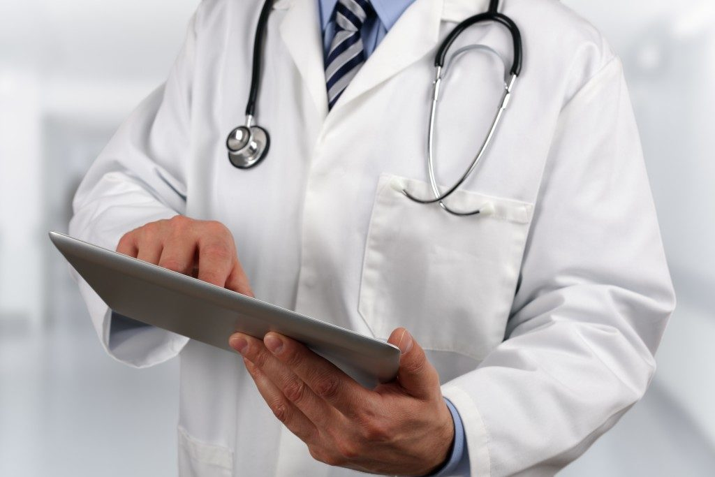 Doctor in hospital using a digital tablet