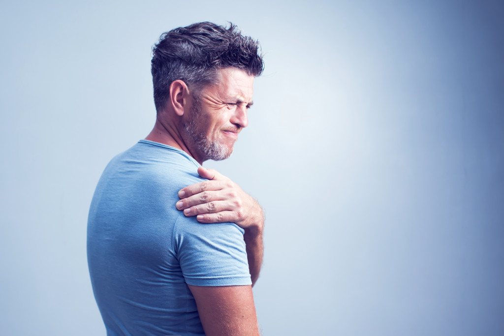 Man experiencing muscle strain