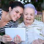 grandma and granddaughter taking a selfie
